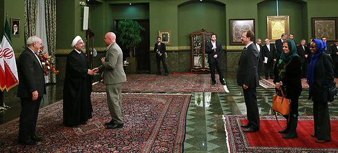 Rouhani greeing foreign ambassadors in Tehran (Photo: AP)
