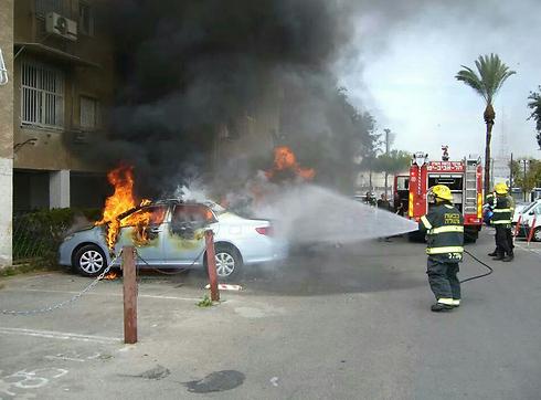 A car set ablaze in Gaza street in Jaffa.