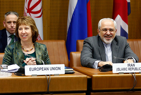 EU's foreign policy chief with Iranian counterpart in Geneva (Photo: Reuters)