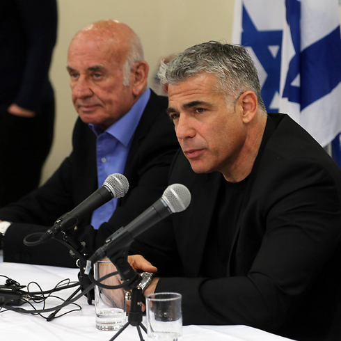 Science Minister Yaakov Perry and Finance Minister Yair Lapid (Yogev Atias)