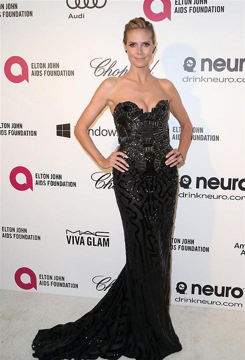 היידי קלום נראית כאילו הגיעה באותה שמלה כמו תמיד (צילום: AFP) (צילום: AFP)