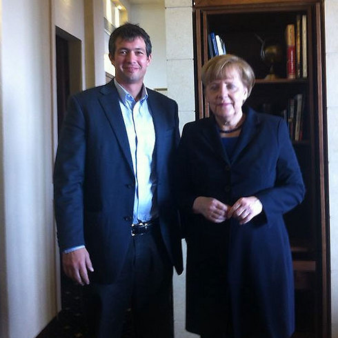 Hendel with German Chancellor Angela Merkel