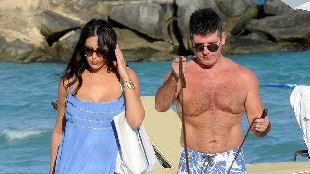 Cowell with Jewish girlfriend Lauren Silverman. 'He did it to impress her' (Photo: Splash News)