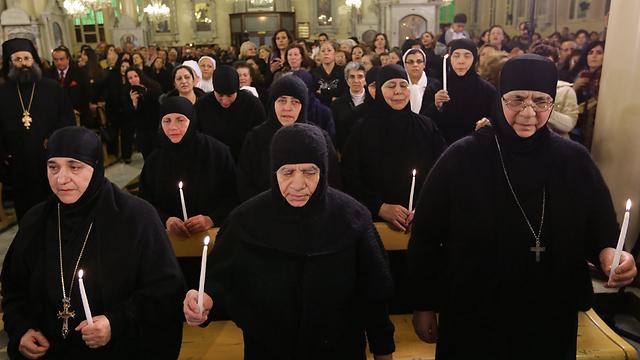 Freed nuns pray (Photo: AFP)