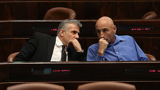 Finance Minister Yair Lapid with Yesh Atid MK Ofer Shelah. 'Nothing happened for six months' (Photo: Gil Yohanan) (Photo: Gil Yohanan)