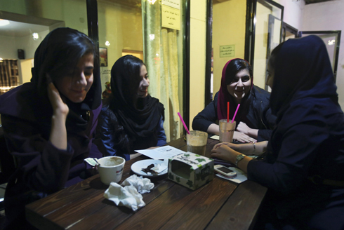 Young Iranian ladies meet at a cafe in Tehran, Iran (Photo: AP) (Photo: AP)