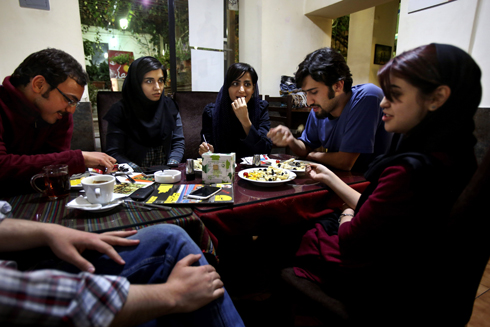 Young Iranian adults sit at a cafe in Tehran (Photo: AP) (Photo: AP)