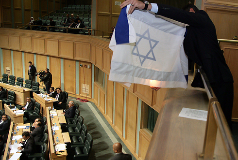 Burning an Israeli flag in the Jordanian parliament (Photo: AFP)