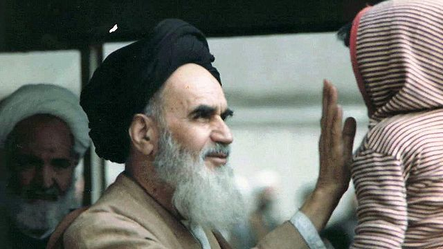 Ayatollah Ruhollah Khomeini, who supported violent revolution