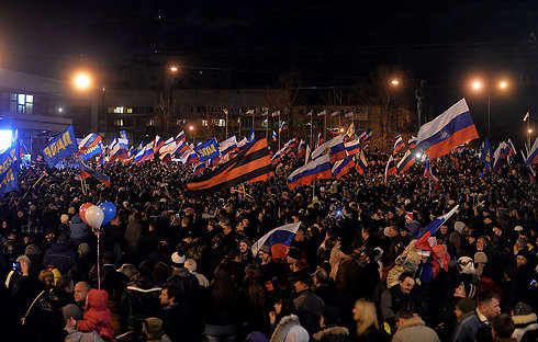 Celebrations in Lenin Square in Simferopol after referendum exit polls show majority in favor of rejoining Russia. (Photo: AFP)