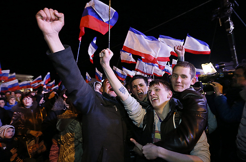 Celebrations in Lenin Square in Simferopol after referendum exit polls show majority in favor of rejoining Russia. (Photo: EPA) (Photo: EPA)
