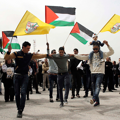 Palestinians dancing during protest (Photo: Reuters)
