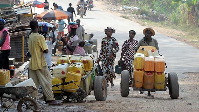 כפר בגינאה שבאפריקה. ארכיון (צילום: AFP) (צילום: AFP)