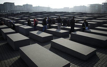 Tourists visit the Holocaust Memorial in central Berlin (Photo: AP)