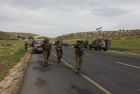 IDF soldiers at the scene of the attack (photo: Gil Yochanan)