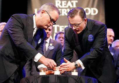 Interfaith leaders light memorial candles for victims (Photo: AP)