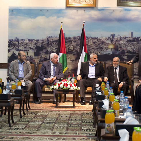 Fatah and Hamas delegations meet in Gaza (Photo: AFP)