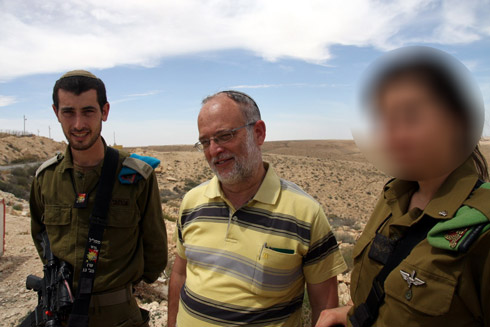 Netanel Yahlomi's bereaved father, S. and his commander standing where Netanel had died (Photo: Roi Idan)