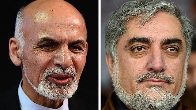 הבטיחו לחתום על הסכם להשארת כוח אמריקני באפגניסטן. עבדאללה (מימין) וראני (צילום: AFP) (צילום: AFP)