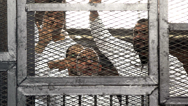 Badie with Brotherhood men behind bars (Photo: AP)