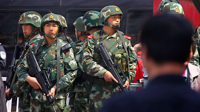 Chinese soldiers in the Uighur populated city of Urumqi (Photo: Reuters)