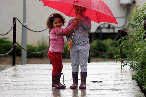 Children sheltering from the rain in Kibbutz Kfar Aza (Photo: Roee Idan) (Photo: Roee Idan)