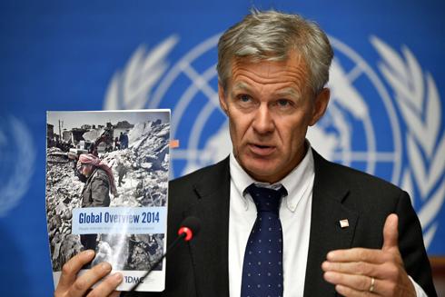 """דו""""ח קשה. מזכיר המועצה הנורבגית לפליטים ז'אן אגלנד (צילום: AFP) (צילום: AFP)"""