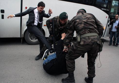 Yusuf Yerkel caught on camera kicking a protester (Photo: AP)
