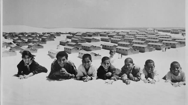In this 1971 photo from the UNRWA archive, Palestinian refugees pose for picture in the New Amman refugee camp in Eastern Jordan (Photo: AP) (Photo: AP)