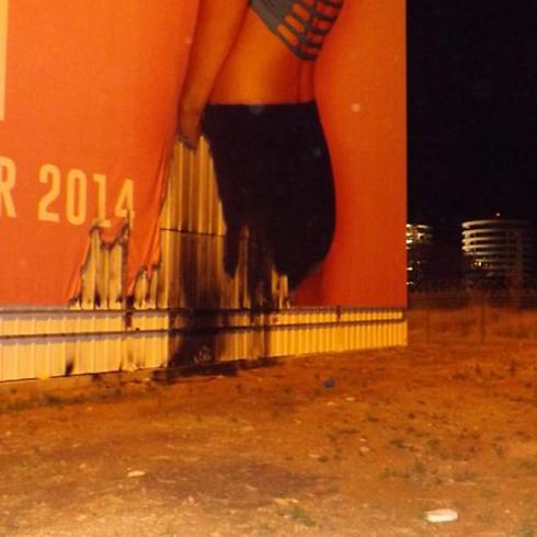The burnt Bar Refaeli billboard (Photo: Herzeliya Fire Dept. Spokesman)