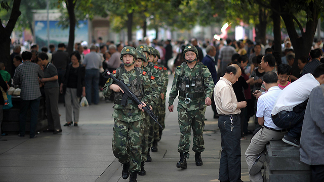 Chinese soldiers patrol the streets of the Uigher majority city of Urumqi in Western China (Photo: AFP)