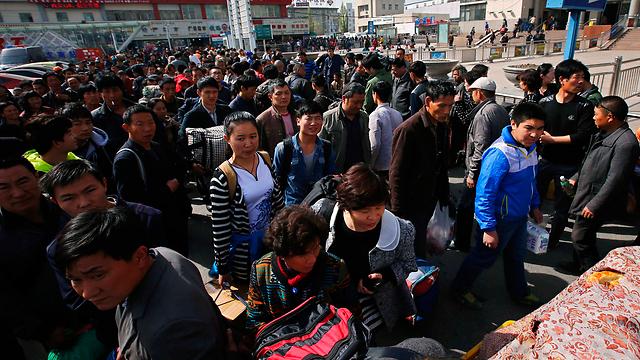 Uighers in Urumqi, the capital of Xianjiang province, western China (Photo: Reuters)