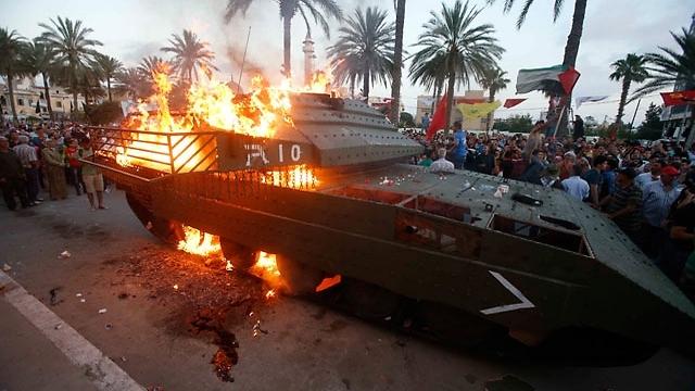 The Israeli tank on fire in Sidon
