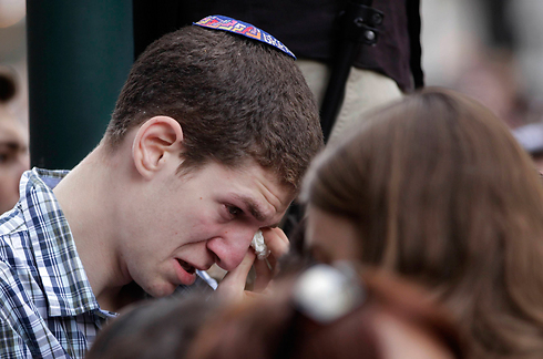 A Belgian Jew brought to tears amidst Sunday's solidarity protests. (Photo: AP)