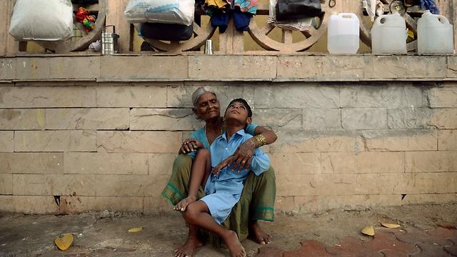 """מומבאי. """"מקום קשה ומאתגר, דווקא בגלל הקושי והניגודיות"""" (צילום: AFP)"""