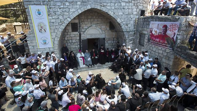 Cardinal Bechara Rai gathers with supporters next to a church in the ruins of the village of Kufr Birim (Photo: AP) (Photo: AP)