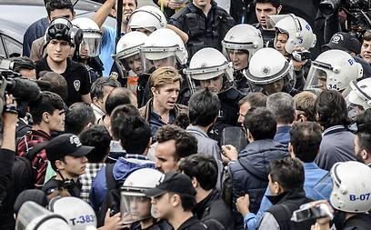 Turkish riot police officers detain CNN International correspondent Ivan Watson at Taksim Square (Photo: AFP)
