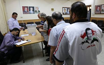 Syrians at the polls (Photo: AFP)