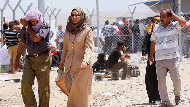 כחצי מיליון תושבים ברחו ממוסול (צילום: AP) (צילום: AP)
