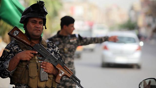 Police officer in Baghdad (Photo: AFP) (Photo: AP)