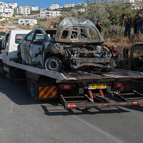 Remains of burnt-out car involved in kidnapping (Photo: EPA)