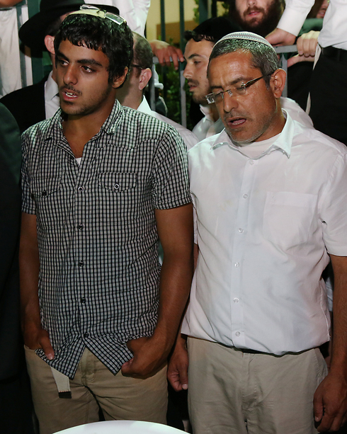 Eyal Yifrach's father, Uriyah, and brother, Assaf, at the support rally in Elad (Photo: Shaul Golan)