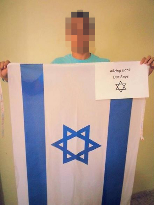 "Arab youth posts picture of himself holding an Israeli flag with the words ""Bring Back Out Boys"""