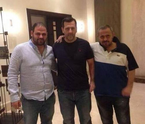 The photo claiming to show Maher Assad (center).