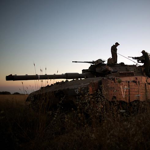 """צה""""ל ערוך בגבול סוריה (צילום: AFP) (צילום: AFP)"""