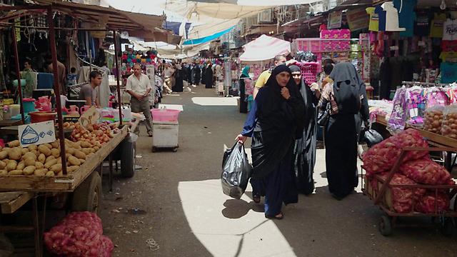 השוק בבגדד. התנועה ערה פחות מבדרך כלל (צילום: AP) (צילום: AP)