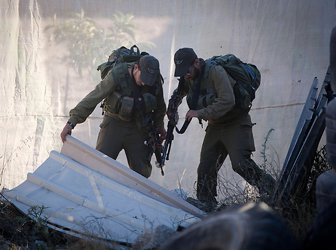 Search efforts in Hebron (Photo: AP)