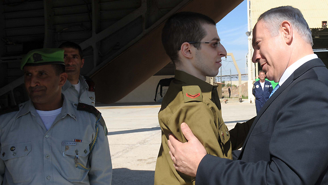 Benjamin Netanyahu embraces Gilad Shalit as he is returned from captivity in Gaza, October 2011 (Photo: GPO)