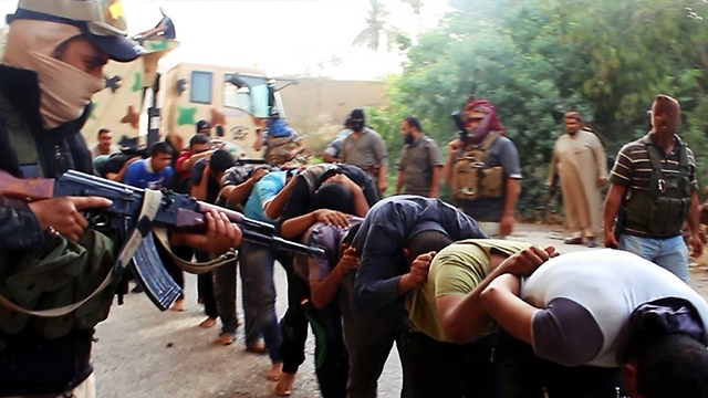 ISIS militants force a column of what they said were captured Iraqi soldiers who they later executed. (Photo: AP) (Photo: AP)