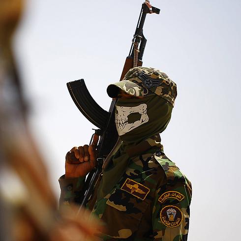 Shi'ite fighter near Najaf (Photo: AFP)